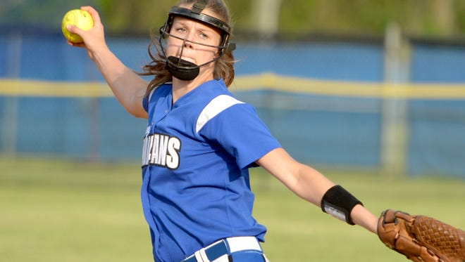 Fort Defiance pitcher Megan Good delivers a pitch during the fourth inning of a softball game played in Fort Defiance on May, 14, 2014.