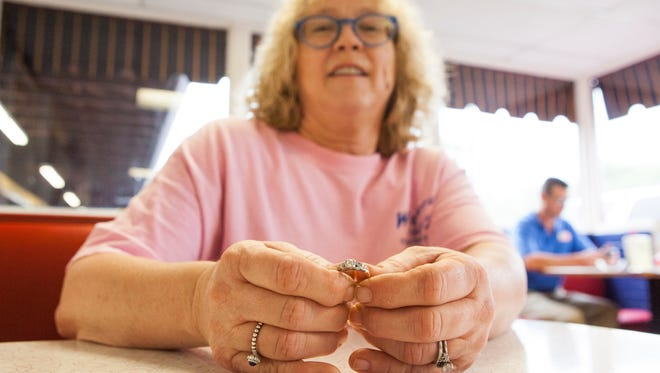 Sandy Kaye Cash, the manager at Wrights Dairy Rite, shows off a wedding ring lost at the restaurant in hopes that it can be reunited with the traveling owner who left it behind.