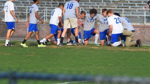 Their game postponed, Robert E. Lee boys' soccer team