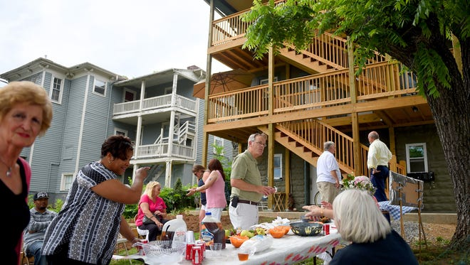 Tenants and visitors mingle during an open house at the Valley Area Community Support Inc.'s apartment building on Kalorama Street in Staunton on Thursday, May 28, 2015.