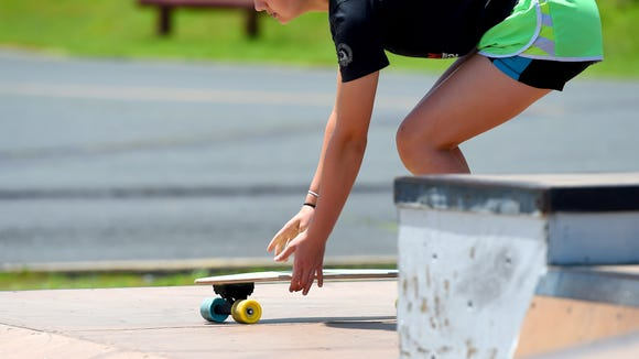 Madie Shifflett sets her skateboard into position as she practices.