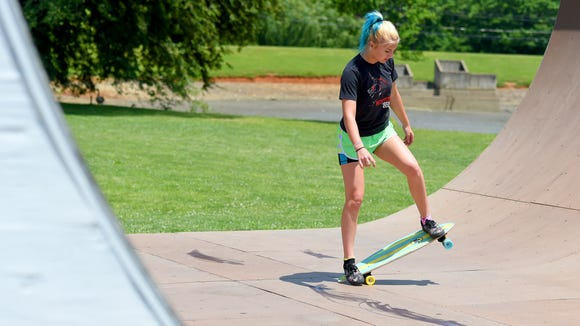 Madie Shifflett, 13, of Fishersville works with her skateboard while at Gypsy Hill Park's skate park.