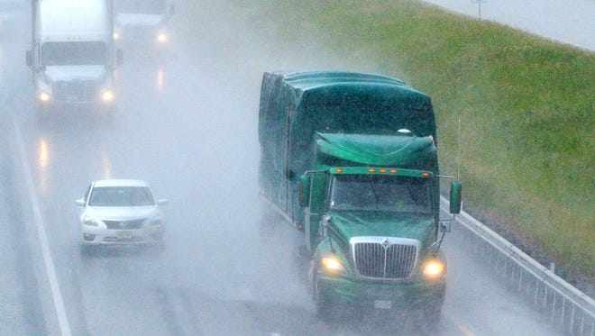 Falling rain partially obscures traffic following a tractor-trailer traveling south on Interstate 81 at Staunton on Tuesday, May 27, 2014.