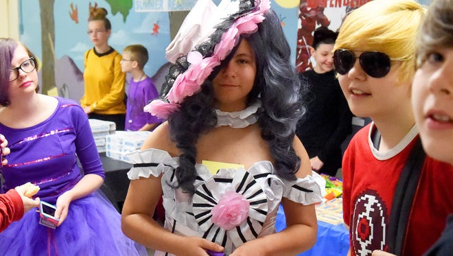 Joanna Goren, 15, of Staunton portrays Ciel Phantomhive while friend Dave Gilbert, 14, of Waynesboro (right) is dressed as Dave Strider. Valley Comic Con wrapped up on at Augusta County Library in Fishersville on Saturday, June 27, 2015. The event three day event also took place in Staunton Public Library on Thursday and Waynesboro Public Library on Friday.