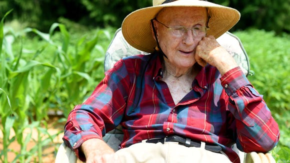 Thomas Lowery remembers a time when he helped his father harvest potatoes in his father's garden. He takes a break from pulling weeds in his on garden behind his home on Lyndhurst Road in Waynesboro on Tuesday, June 30, 2015.