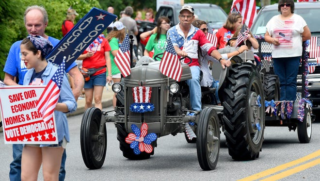 A tractor is decorated and driven in the parade. America's Birthday Celebration held its annual parade in Gypsy Hill Park on Saturday, July 4, 2015.