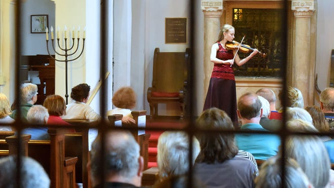 "Sophia Steger performs ""Violin Sonata No. 2 in A minor"" by Johann Sebastian Bach on her violin. Heifetz International Music Institute students performed one-by-one for those gathered at the Temple House of Israel. After playing a selection, students would answer questions from the audience as part of ""Heifetz at Temple House"" in Staunton on Monday, July 6, 2015."