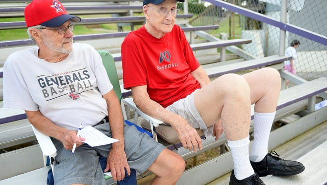 Thomas Lowery, right, sits next to Quinlyn Dofflemyer in the stands at the Waynesboro Generals' home game against the Staunton Braves at Katie Collins Field on Wednesday, July 15, 2015. Whereas Dofflemyer has been a fan of the Generals for the past 7 or 8 years, Lowery marks decades as a fan.