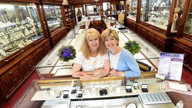 Katie Spurlock (right) and Allison Fitzgerald are the new owners of H.L. Lang & Co. Jewelers. The sisters are photographed in the business they run together in downtown Staunton on Wednesday, July 15, 2015.