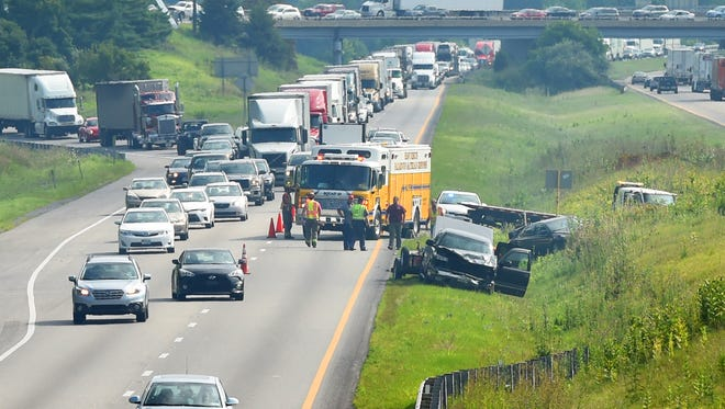 A wreck on Interstate 81 near the Interstate 64 interchange snarls traffic as first responders remain on the scene Friday, July 17, 2015.