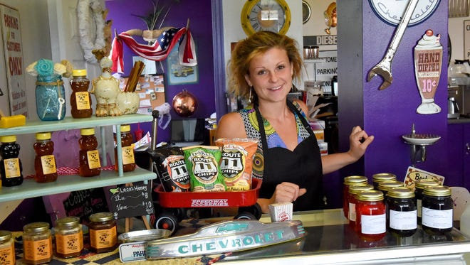 "Business owner Becky Kincaid finds a lot of pride in her business, the Purple Cow Ice Cream Parlor, which she opened on U.S. 340 just north of Waynesboro. ""It's the people that make it worth it,"" says Kincaid about her customers and business."