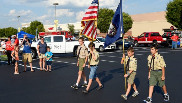 Members of Boy Scout Troop 73 act as color guard. They