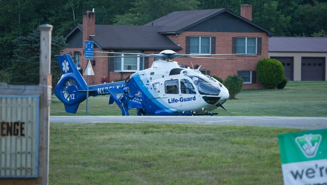 A Life-Guard helicopter prepares to take off from a field in West Augusta and transport an injured patient to the hospital on Friday, Aug. 14, 2015.