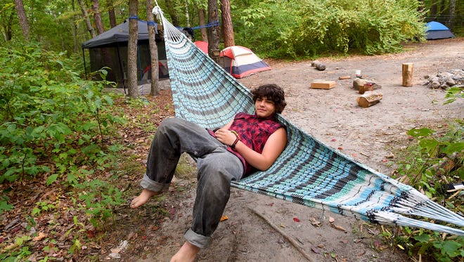 "Nathaniel Chaffin of Richmond lounges back in a hammock alongside the campsite he shares with friends while they are off elsewhere. They camp adjacent Kennedy Creek along Cole Road in the George Washington National Forest on Friday, August 28, 2015. ""I just love the outdoors,"" says Chaffin. ""This is like my third time coming here."""