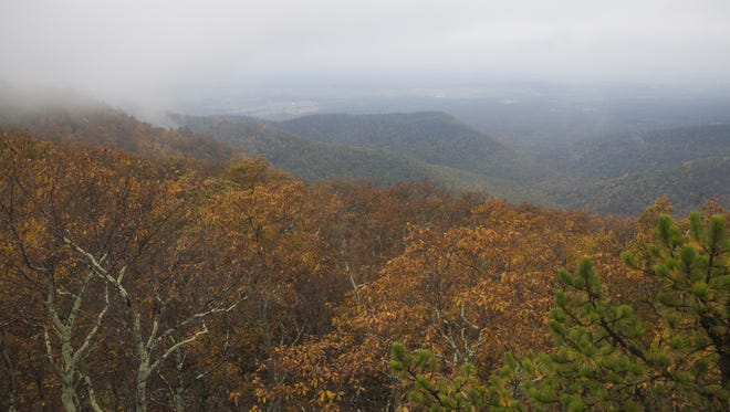 Clouds partly obscure the view from atop Calvary Rocks in the Shenandoah National Park on Sunday, Oct. 12, 2014.