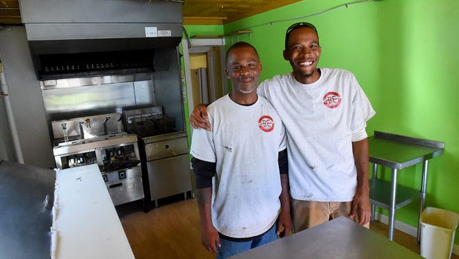 """Co-owners Antoine Breckenridge and David Bell stand inside the space they are transforming into their new business, """"I-C Wings"""" in Staunton on Tuesday, Oct. 13, 2015. The business is located at 300 North Central Avenue."""