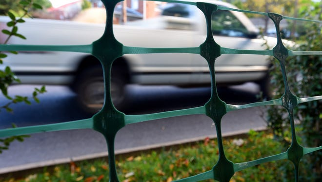 A pickup truck traveling along Churchville Avenue is viewed from across a temporary fence at Gypsy Hill Park on Wednesday, Oct. 14, 2015. The temporary fence was put up following a recent accident involving a small child.