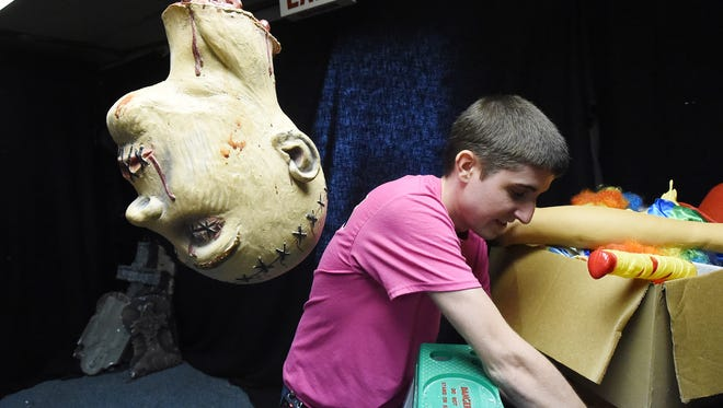 Rescue deputy chief Logan Parker hangs up fake body parts as he helps set up a haunted house in the community room at the Stuarts Draft Rescue Squad building on Thursday, Oct. 22, 2015. The haunted house will be free to the public and open one night only only on Halloween night.