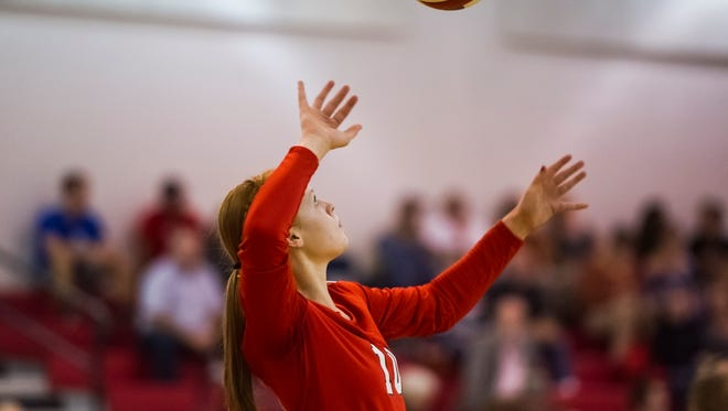 Riverheads' Blake Bartley lines up a serve during their volleyball game against Wilson Memorial on Thursday, Oct. 22, 2015.