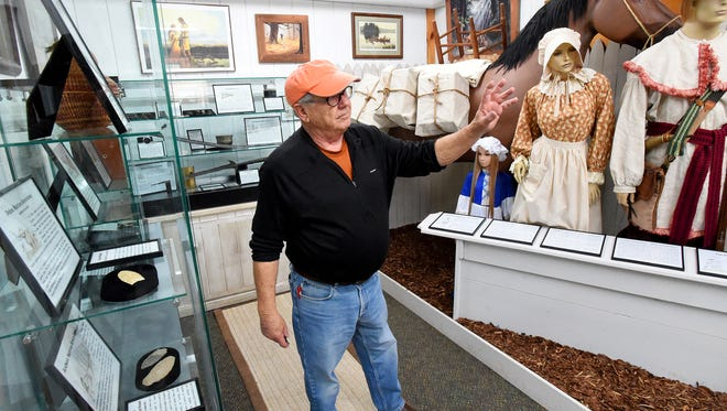 "Gordon Barlow talks about the various items he has on display in  ""The Story of Virginia"" museum, located inside Wilderness Adventure, during an interview in Staunton on Tuesday, Nov. 17, 2015. The artifacts are just some of the historical items he has collected over the past several decades."