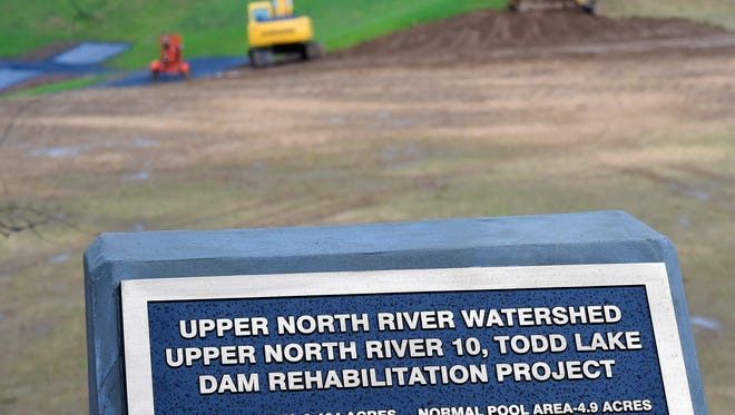 A sign near Todd Lake recognizes the Todd Lake Dam Rehabilitation Project on Wednesday, Dec. 30, 2015.