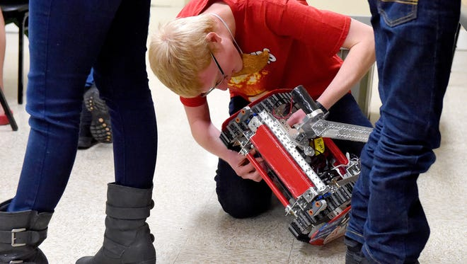David Fenneran, 17, of Tech Busters 8275 works on his team's robot at Augusta County Library in Fishersville on Tuesday, Jan. 26, 2016.