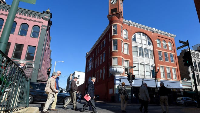 Participants in a walking tour of downtown Staunton cross Central Avenue.