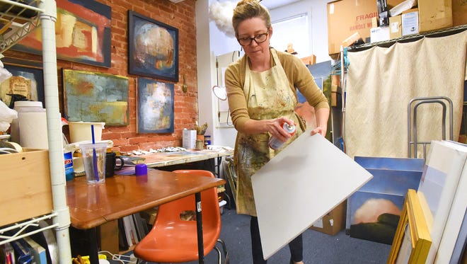 Leslie Banta, owner of Staunton Art  Supply, works in the back room of her business on Central Avenue in Staunton on Tuesday, March 15, 2016. Banta has put her store up for sale, wanting to spend more time at home with her family.