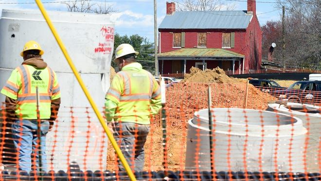 The 19th-century red brick Arnold House on New Hope Road is viewed across the Walmart grocery store construction site, from Broad Street, in Waynesboro on Friday, March 18, 2016.