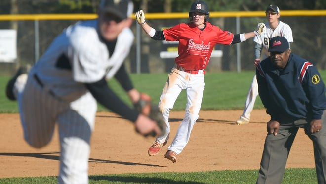 Riverheads' Keegan Oliver watches the pitch as he takes a lead off second base in the second inning during a baseball game played in Swoope on Tuesday, April 5, 2016.
