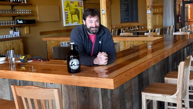 Owner Craig Nargi is photographed in the tasting room at Stable Craft Brewing, located at Heritage Hill Farm and Stables on Madrid Road in Augusta County on Thursday, April 14, 2016.