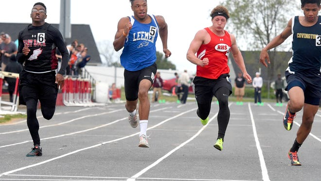 Robert E. Lee's Iyion Oravitz and Riverheads' Landon Diehl race for the finish between East Rockingham's Livi Person and Covington's Kiante Barber in the boys' 100 meter dash during the 28th annual Augusta County Invitational Track Meet held in Greenville on Friday, April 29, 2016.