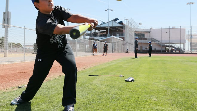 David Valadez practices bunting at the El Paso County Sportspark during its recent grand reopening.