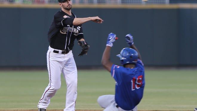 El Paso shortstopo Nick Noonan throws over sliding Round Rock baserunner Jurickson Profar to complete a double play Friday.