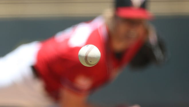 El Paso starting pitcher Daniel McCutchen delivers a pitch to a Round Rock hitter Sunday.