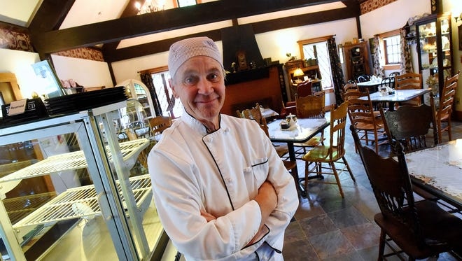 Originally from Manchester England, Alfred Farrand co-owns the Anne Hathaway Cottage Tea Room with his wife in Staunton. He is photographed within the establishment on Monday, May 23, 2016.