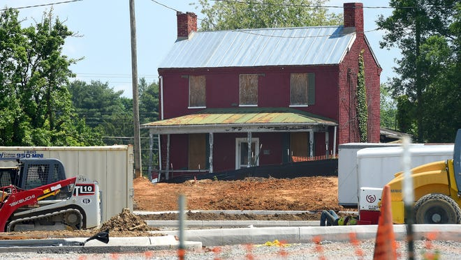 The 19th-century red brick Arnold House on New Hope Road is viewed across the Walmart grocery store contraction site, from Broad Street, in Waynesboro.