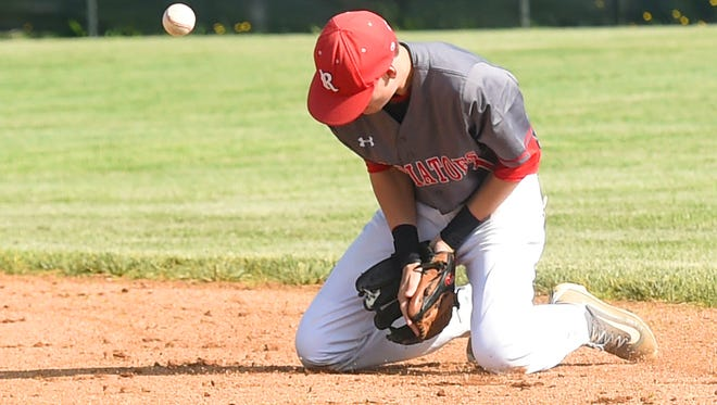 The ball bounces away from Riverheads' Keegan Oliver who fields a grounder in the second inning during the Conference 44 championship baseball game played in Greenville on Wednesday, May 25, 2016.
