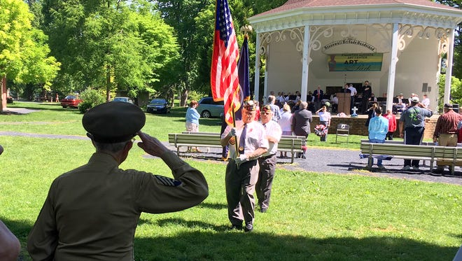 The colors are retired at the end of a Memorial Day remembrance program, held at the Gypsy Hill Park bandstand on Monday, May 30, 2016.