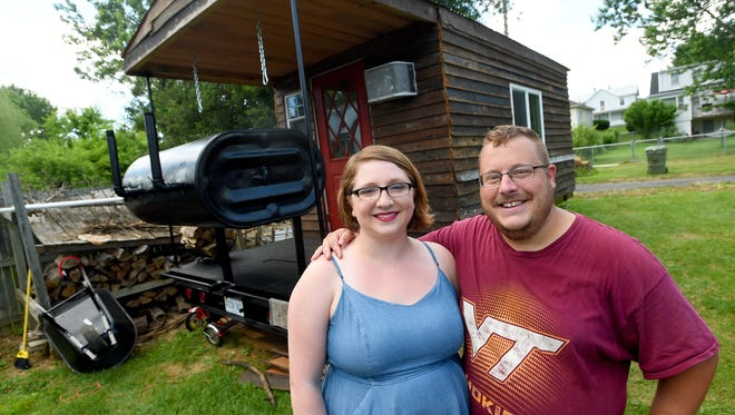 Andy Price (right) and Jami DeCourcy have been building their dream Ñ the Magnolia Mountain Grill which will serve as their food truck. They are photographed near it, outside their Waynesboro home on Thursday, June 16, 2016. The couple hopes to be serving customers within the next month.