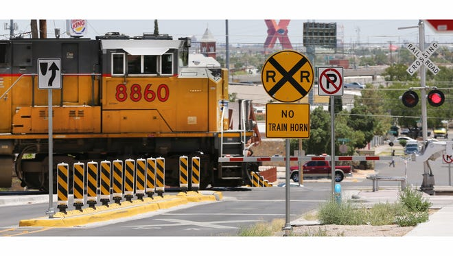 A train heads west on the tracks at Rosewood Street west of North Piedras Street in Five Points.