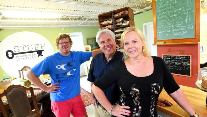 "Cafe manager Zach Sowers (left) of ""The Accidental Cafe"" is photographed with parents and owners Patrick and Karen DiFlorio at Stuff: Antique and Vintage Interiors in Staunton on July 13, 2016."