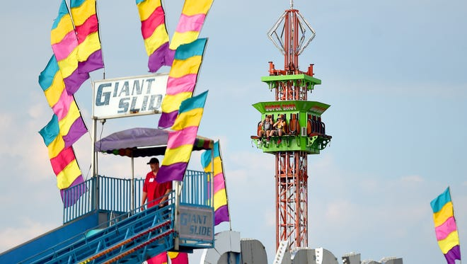 Fair-goers ride the Super Shot on the midway during the first day of the Augusta County Fair on Tuesday, August 2, 2016. The fair continues through Saturday.