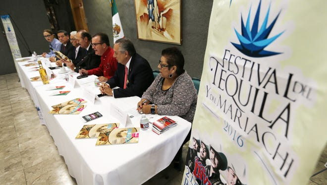 Alejandro Ramirez, president of the Mexican Chamber of Commerce in Juarez, center in red, talked about the upcoming Festival del Tequila y del Mariachi to be held Sept. 1, 2 and 3 in Ciudad Juarez.