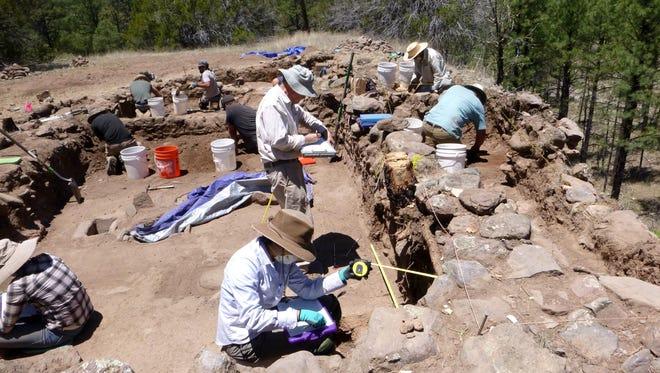 Fumi Arakawa and his team excavating land at the South Diamond Creek Pueblo.