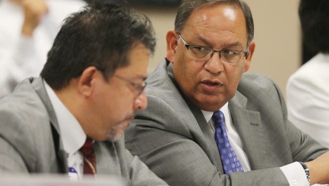 Jacob Cintron, president and CEO of University Medical Center of El Paso, right, speaks with UMC Chief Financial Officer Michael Nuñez during a budget work session with county commissioners in August 2016.