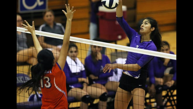 Franklin's Brianna Garza hits against Eastlake's Stephanie Sanchez last month. Garza is one of the top players in the city for the No. 2 ranked Cougars.