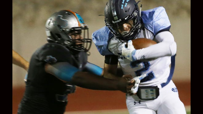 Chapin's Christian McKeever runs through a tackle attempt by a Pebble Hills defender Sept. 8.