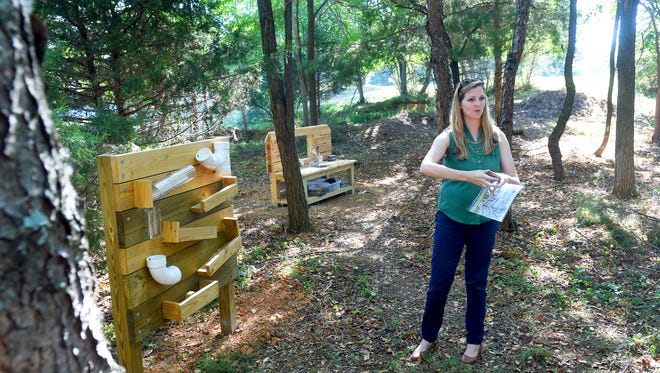 With a tracking panel and dirt kitchen behind her, recreation manager Claire Richardson with Staunton Parks and Recreation talks about the planned layout for the natural play area currently being developed at Montgomery Hall Park. She talks during an interview in Staunton on Wednesday, Sept. 14, 2016.