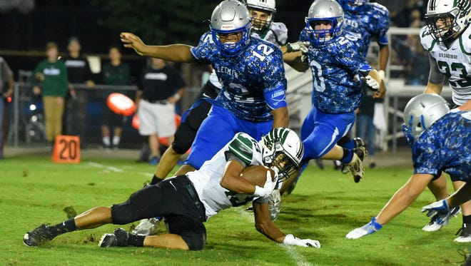 Robert E. Lee's Jaymond Venable-Chisley makes sure Broadway's David Osorio goes down with the football during a football game played in Staunton on Monday, Oct. 3, 2016.